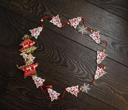 Frame from Christmas toys on wooden background Stock Images