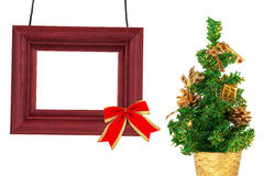 The frame and Christmas tree in a basket Stock Images