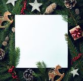 Frame of Christmas tree branches and decorations stock photo