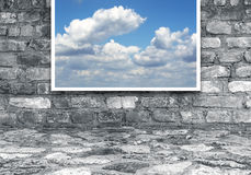 Frame with clouds on brick wall Royalty Free Stock Images