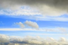 Cloudy frame in blue sky. Frame from clouds in vivid blue sky Stock Photography