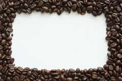 Frame from coffe. The frame of the roasted coffee on a white background stock photos