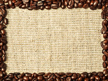 Frame from coffee beans. On burlap background stock photo