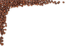 Frame of coffee beans. Frame of red brown coffee beans on white royalty free stock image