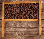 Frame with coffee beans and celyon cinnamon Stock Photography