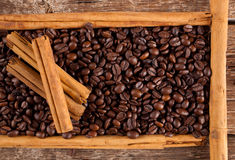 Frame with coffee beans and celyon cinnamon Royalty Free Stock Photos