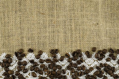 Frame of coffee beans on linen background. Beautiful frame of coffee beans on linen background Royalty Free Stock Images