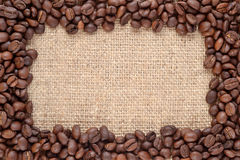Frame of coffee beans in a sacking background Stock Images