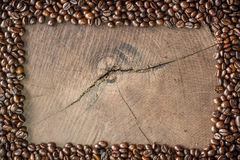 Frame of coffee beans on stump. Frame of coffee beans on wood background Royalty Free Stock Photography