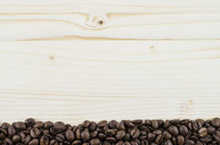 Frame of coffee beans on wooden table. Background Stock Images