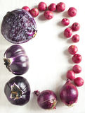 Frame from collection of fresh purple toned vegetables. On white background Royalty Free Stock Photography