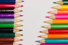 Frame of colored crayons Royalty Free Stock Photos