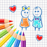 Frame of colored pencils on the background exercise book in a cage, with painted cartoon girl and boy. For design Stock Images