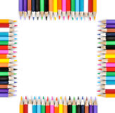 Frame of colored pencils isolated on white. Background stock photos