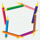 Frame of colored pencils. On notebook Royalty Free Stock Photos