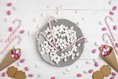 Frame Candies and cookies in the form of heart Top view White wooden Background. Frame colorful Candies, Striped Lollipops and cookies in the form of heart on Royalty Free Stock Photography