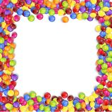 Frame of colorful candy on a white background Stock Images