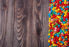Frame of colorful candy on wood background Stock Photo
