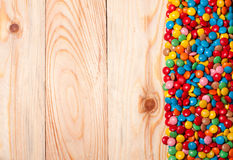 Frame of colorful candy on wood background Stock Photography