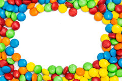 Frame of colorful chocolate candy on white background with space Royalty Free Stock Photos