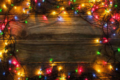 Frame of the colorful Christmas festoon on the wooden board Royalty Free Stock Photography
