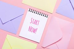 Frame from colorful envelopes and notepad on pink table top view. stock photos