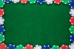 Frame of Colorful gambling chips on green background with copy space royalty free stock photography
