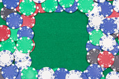 Frame with colorful poker chips on the green table Royalty Free Stock Photo