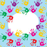 Frame with colorful prints of childrens hands Royalty Free Stock Images
