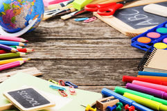 Frame with colorful school supplies stock image
