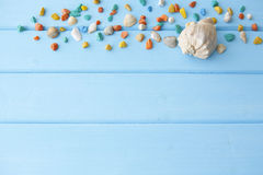 Frame of colorful stones with a two seashell Stock Photography