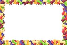 Frame colorido do biscoito de cão Fotos de Stock Royalty Free
