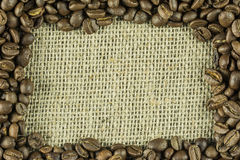 A frame composed of coffee beans. And jute bag Royalty Free Stock Images
