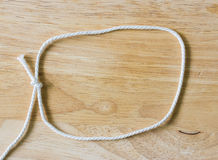 Frame composed of Rope on a Wooden Stock Image