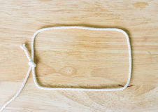 Frame composed of Rope on a Wooden Royalty Free Stock Images