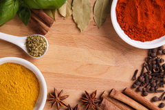 Frame composition of spices on wood Stock Photography