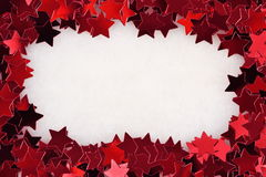 Frame of confetti in the form of red stars Stock Photography