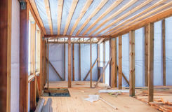 Frame Construction Of Wooden House. Frame construction of a wooden house using a vapor barrier. Inside view, selective focus stock images
