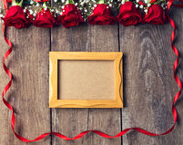 Frame for copy space with beautiful red roses. Background Stock Photo