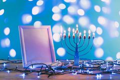 frame with copy space traditional hanukkah menorah and cookies with bokeh blue lights stock photos