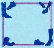 Frame cor-de-rosa com sapatas azuis Foto de Stock Royalty Free
