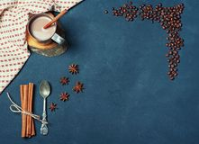 Frame of Cup of Cacao Coffee Beans Cinnamon sticks Spoon on Dark Texture Table decorated with Napkin. Kitchen Ingredients Winter. Or Autumn Composition. Flat Royalty Free Stock Images