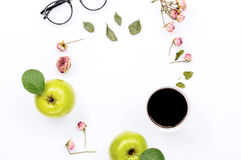 Frame with cup coffee, apple, glasses and dry rose flowers Royalty Free Stock Photo