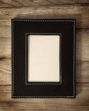 Frame de couro na madeira Fotos de Stock Royalty Free