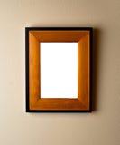 Frame de madeira bonito na parede. Imagem de Stock
