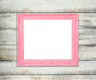 Frame de retrato cor-de-rosa do vintage no fundo de madeira azul Fotografia de Stock