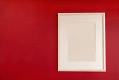Frame de retrato na parede vermelha Imagens de Stock Royalty Free