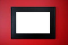 Frame de retrato preto na parede vermelha Fotos de Stock Royalty Free