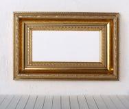 Frame de retrato velho em uma parede Imagens de Stock
