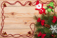 Frame decorated Christmas fir branch on a light wooden background Stock Images